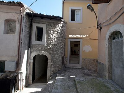 Photo for Baronessa 1 - Old medieval rustic house renovated in the center of the village