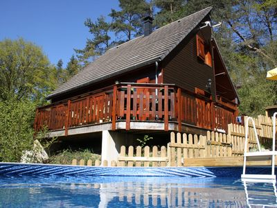 Photo for Tasteful chalet with above-ground pool near a lake with sand beach