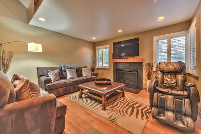 "Living Room with Comfortable Furnishings, a Massage Chair, a Gas Fireplace and a 50"" Samsung TV"