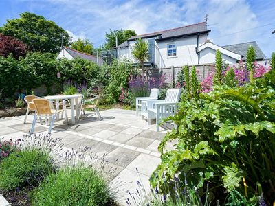 Photo for Positioned at the top of Abersoch's high street, this welcoming two-storey apartment not only benefi