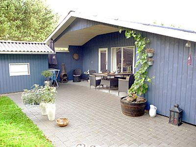 Photo for Beautiful blue wooden house on a large wooded plot