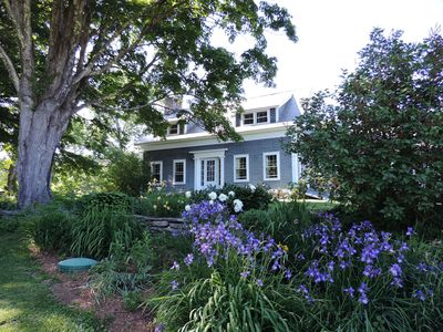 Front of main house. Kitchen wing behind bush. Flower Gardens surround our home