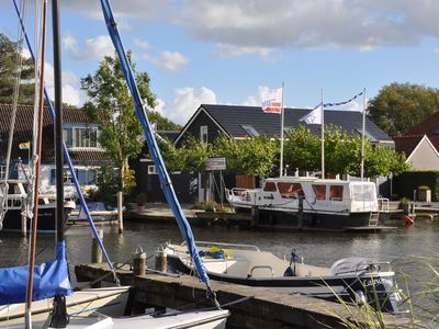 Photo for Uniquely situated, designer apartment on open waterway between Joure and Sneek