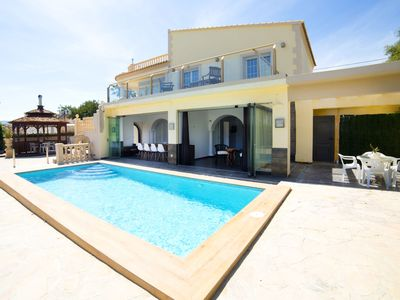 Photo for This 8-bedroom villa for up to 16 guests is located in Calpe and has a private swimming pool, air-co