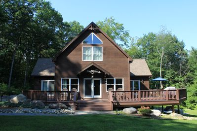 Front of the house with large wrap around deck.