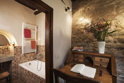Looking from sitting room to bathroom with tub