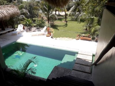 Photo for Stunning Beach House/Garden Paradise situated steps from your private beach.