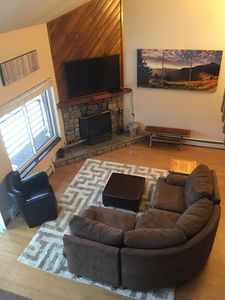 Living area with wood fireplace, cable TV and BluRay player