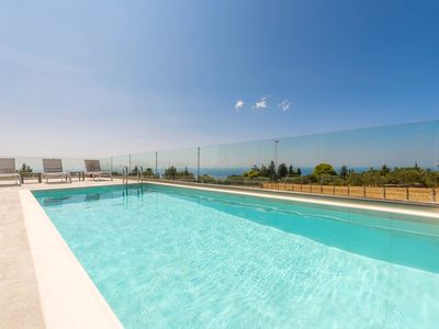 Photo for Three-Bedroom Apartment with Private Pool
