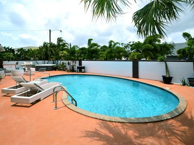 Luxurious duplex with private pool and hot tub within one mile of the ocean.