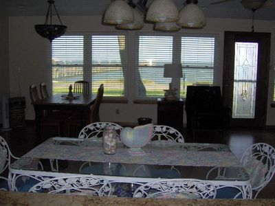 Water View from kitchen sink to front of home. Lots of seating. PIER IS NOT OURS