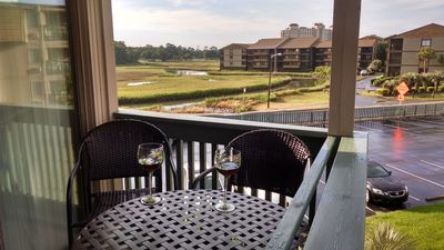 Opposite view from Balcony - golf course and inlet -