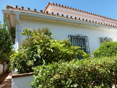 Photo for Spanish style house with enclosed garden & upstairs terrace close to beach