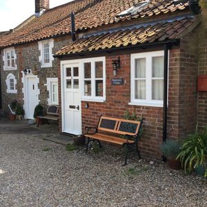 Photo for A Traditional Brick And Flint North Norfolk Cottage