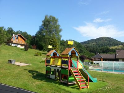 "Photo for chalet ""Small Happiness"" with garden, game area, peace and quiet - SKI - swimming pool may to september"