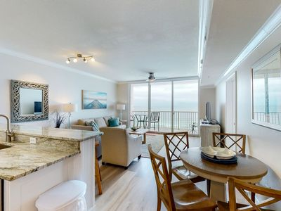 Photo for Updated beachfront condo w/ views, pools, hot tubs, gym & beach service!