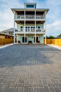 Three oversized decks facing the beach across the street plus parking for 9 cars