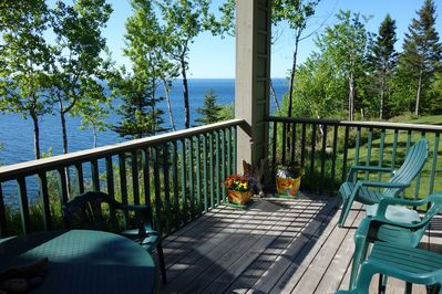 Covered lower deck brings you close to the lake.