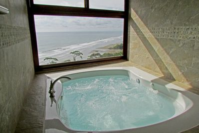 Private Jacuzzi with picture window view in the Honeymoon Sunset Suite