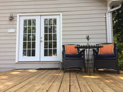 Enjoy your coffee or wine on your personal deck shaded by the giant red oaks.