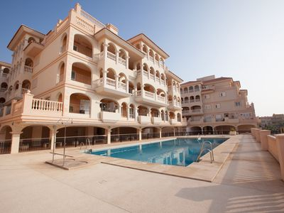 Photo for Beautiful 2 bedroom apartment with stunning seaview, sunny terrace & golf