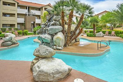 Cool off in the community pool of this Las Vegas vacation rental condo.