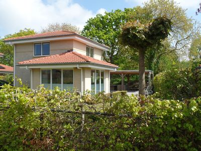 Photo for A beautiful holiday home in a unique location just steps from the dunes and the sea with large garden.