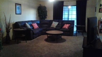 Family room with sectional and recliners on each end.  Enjoy cozy fireplace.