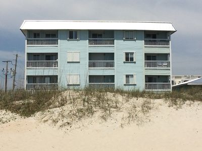 Located right on the sand. Your balcony is the middle floor on the right