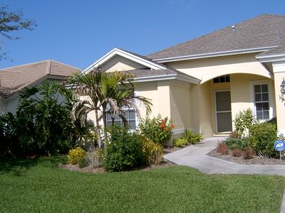 Photo for Lakefront home with pool, tennis,golf close to beach, restaurants & shopping