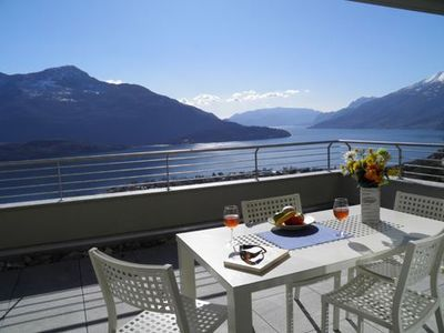 Photo for Sunny cozy apartment in the Valarin Wellness Resort Lake Como with indoor pool and stunning panorami