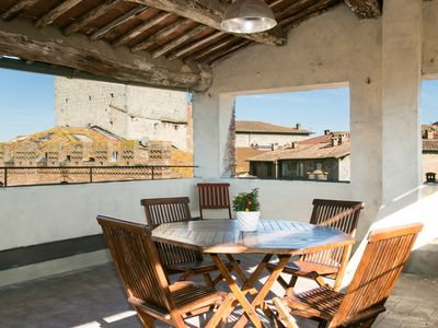 Photo for Penthouse with roof terrace: charm and relaxation among the beauties of Siena