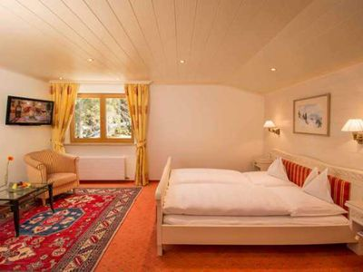 Photo for Family Suite with sloping ceilings and forest views - Hotel Kristberg