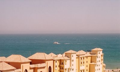 Photo for Air-conditioned penthouse beach apartment, sea and mountain views, Free WIFI