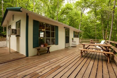 Front of house with wrap around deck