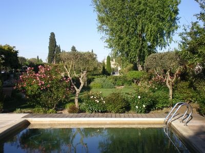 Photo for The heart of a property with flowers and trees, Mazet restored with pool access