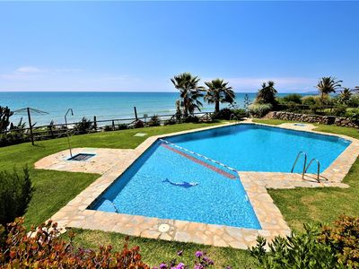 Photo for Spacious family townhouse with WIFI and Aircon, Close to beach, pools and Estepona port