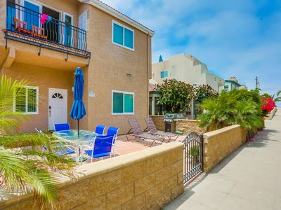 Photo for Retreat to a 2 bedroom condo with a large front patio steps from the ocean.