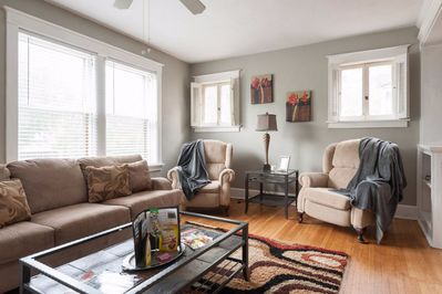 Spacious living space, comfortably seating 6. Stools and dining chairs available