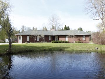 Beautiful air conditioned home on the Boardman River with deck and hot tub.