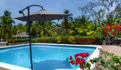 Photo for Beachfront  Great Villa, private, full staffed, pool, sleeps 28, 8 bedrooms