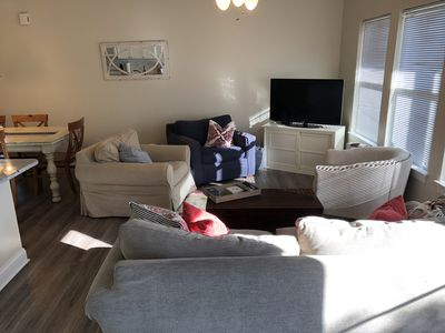 Comfortable den with new laminate flooring