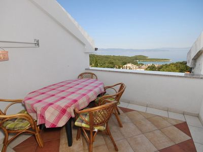 Photo for Two bedroom apartment with terrace and sea view Njivice (Krk) (A-5458-a)