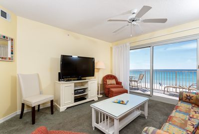 """Family room perfect for both entertaining and relaxing. - Spacious beach front living room offers marvelous views from the 3rd floor. Brand new 47"""" HDTV and Blu-Ray DVD player just added as well as the new white side chair."""