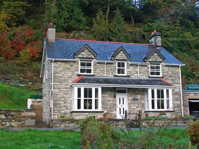 Photo for A classic Welsh period property with exposed stonework and a wood burner stove, Melin Pandy is the p