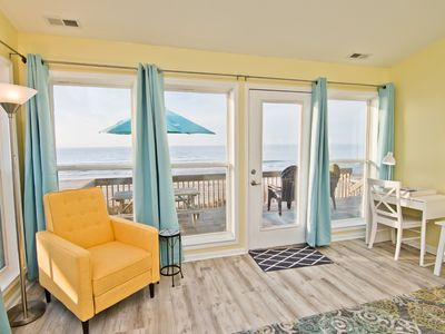 Photo for Stunning oceanfront views just steps from the deck; steps, sand, waves!