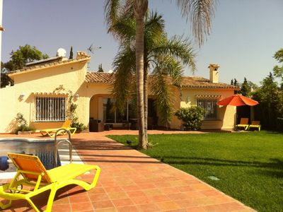 Photo for Luxury detached villa with heated pool in beautiful beachside location with WIFI