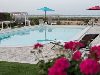 Photo for Exclusive villa with swimming pool just steps from the sea