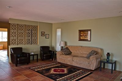 Your living room with flat screen TV and pull out sofa for extra sleeping