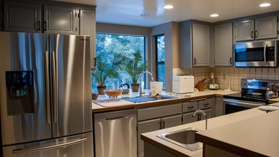 Fully equipped kitchen great lighting, NEW Samsung appl. , stay home to  eat!